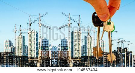 The keys on the background of the construction of new modern buildings . The concept of the development of urban construction .