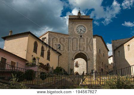 Arch and clock tower in the historic center of Monteleone di Spoleto, Umbria