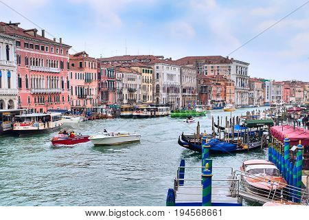 Venice, Italy - November 10, 2014: Romantic venetian canal view with houses, boats and gondola