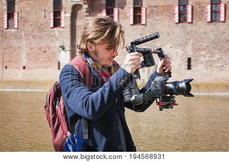 Haarzuilens, Netherlands - April 24 2016: cameraman in action during The Elf Fantasy Fair (Elfia) an outdoor fantasy event in the Netherlands.