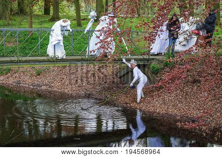 Haarzuilens, Netherlands - April 24 2016: a fairy is dragging the ditch on the guess of another fairy on The Elf Fantasy Fair (Elfia) an outdoor fantasy event in the Netherlands.