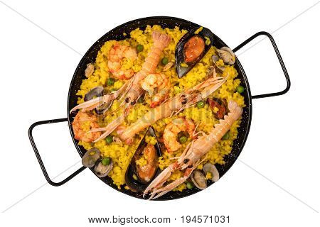 A photo of a Spanish seafood paella in a typical paellera, with mussels, clams, and shrimps, with a place for text, shot from above, isolated on a white background