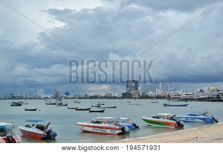 Pattaya Thailand June 03 2013: Speedboats parking on the beach with cloudy sky before raining.