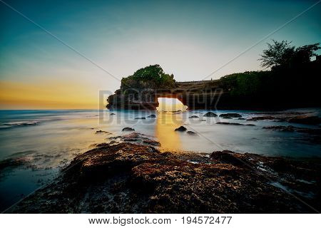 Peaceful Seascape With Warm Sunlight At Tanah Lot Temple Located In Bali Indonesia