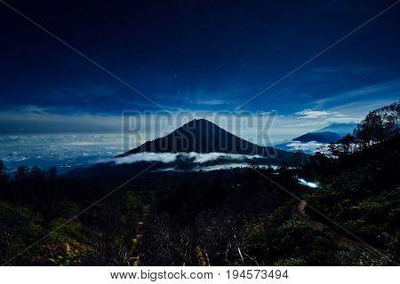 Stars In The Dark Blue Sky And Scenic Mountain Landscape Kawah Ijen Indonesia
