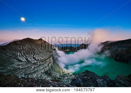 Scenic Dawn Sky With Moon Light And Volcano Texture From Kawah Ijen East Java Indonesia