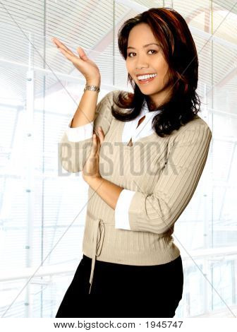 Asian Businesswoman In Presenting Gesturein Office