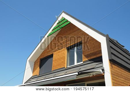 House Blinds Sun Protection Exterior. Windows in New Modern Passive House Facade Wooden Wall with Shutters Closed and Opened Modern House Outdoors. Protection Against Sun and Heat as Energy Saving.