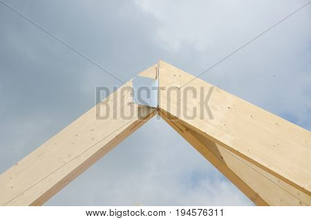 Huge wooden building joint for roof with metal piece