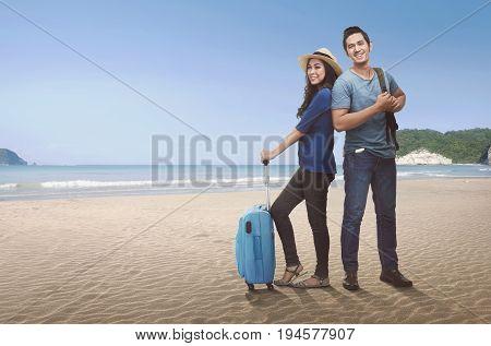 Happy Couple Asian Tourist With Luggage Enjoying Trip