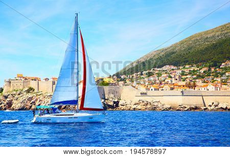 Sail boat near old city walls of Dubrovnik, Croatia