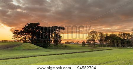 New Zealand farmland in winter time at sunrise.