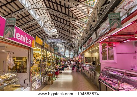 VALENCIA, SPAIN - JUNE 12, 2017: Shops at the colorful mercado central of Valencia, Spain