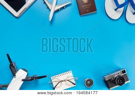 Summer Travel accessories on white blue copy space in the middle