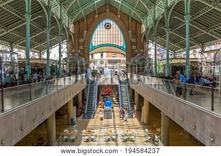 VALENCIA, SPAIN - JUNE 12, 2017: Shops and restaurants at the Mercado Colon in Valencia, Spain