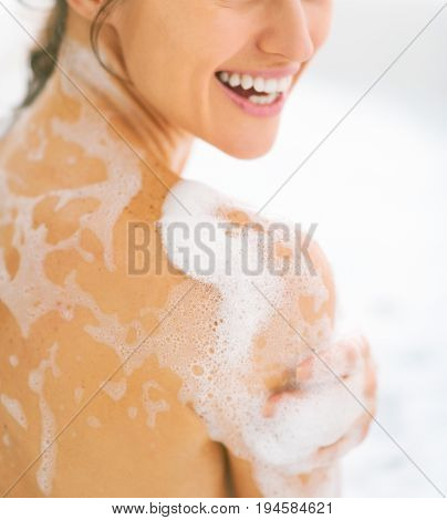 Closeup On Happy Young Woman Washing In Bathtub