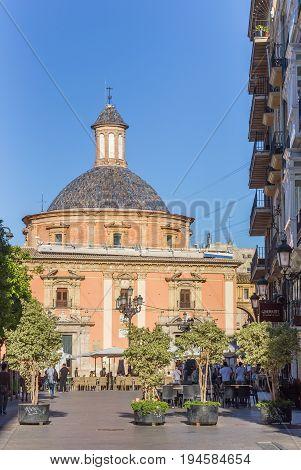 VALENCIA, SPAIN - JUNE 12, 2017: Street leading to the Basilica de la Virgen in Valencia, Spain