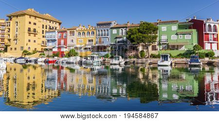 VALENCIA, SPAIN - JUNE 13, 2017: Panorama of boats and colorful houses of Port Saplaya in Valencia, Spain