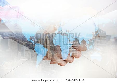 International affairs, composite image business people shaking hands and city skyscrapers