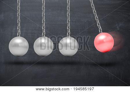 Newton's cradle pendulum on blackboard, abstract image