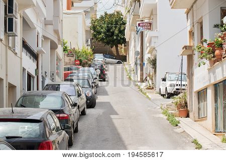 Agis Nikolaos, Crete, Greece - June 13, 2017: Cars parked in the street