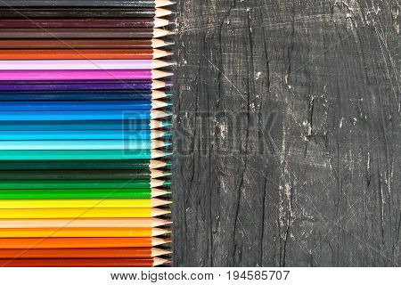 back to school frame of multicolored pensils and chalk board, top view, copy space