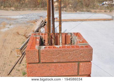 Installing Red Bricks and Caulking Brick Masonry. Bricklaying Masonry.
