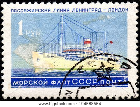 UKRAINE - CIRCA 2017: A postage stamp printed in USSR shows Soviet Liners Ship and Inscription Soviet Navy Passage line Leningrad - London from the series Ships circa 1959