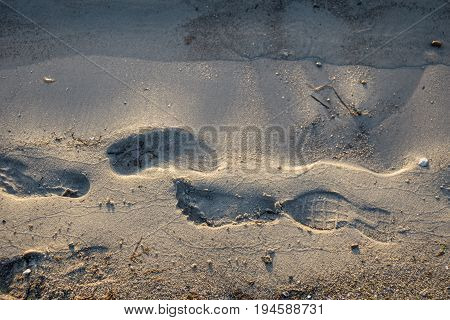 Beach side with wet footsteps after the beach guests