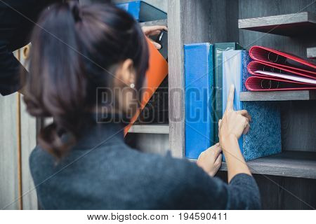 Women Looking For Document At Office Place, Woman Working Concept, Vintage Tone