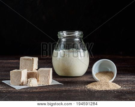 Fresh Pressed Yeast, Dry Instant Yeast And Active Wheat Sourdough Starter On Wooden Table
