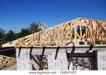 Roof trusses. Roofing Construction House Roof Building.Timber roof truss. Trusses and Framing Home Roof. Engineered Roof Trusses.