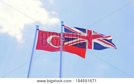 Turkey and Great Britain, two flags waving against blue sky. 3d image