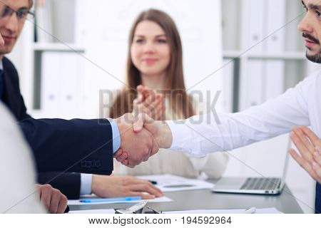 Close up of two business man shaking hands to each other finishing up the meeting.