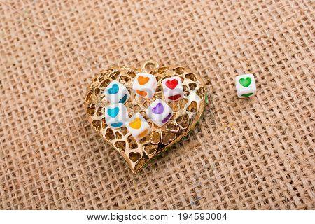 Heart Cubes On Heart Shaped Object