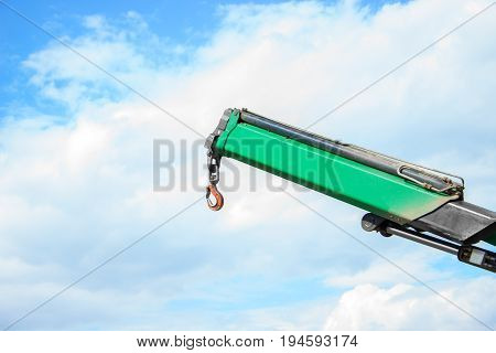 Part of the truck crane. Crane hook against the sky.