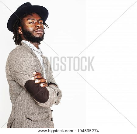 young handsome afro american boy in stylish hipster hat gesturing emotional isolated on white background smiling, lifestyle people concept close up
