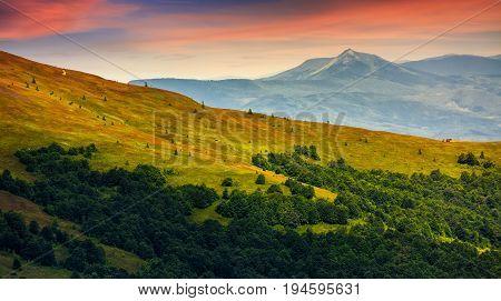 Mountain Ridge With Peak Behind The Hillside At Sunset