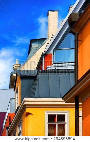 Composition of lines from different colors of the facades of houses in the old city of Riga on a summer day