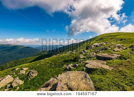 Blue Cloudy Sky Over The Mountains With Rocky Hillside