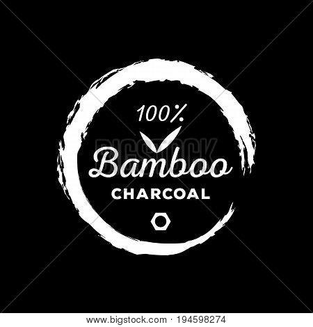 guarantee logo one hundred bamboo charcoal with bamboo leaf round brush stroke surround