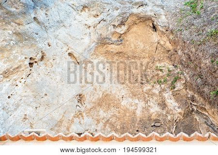 mountain slope stones texture background, dried creeper, tiled roof fragment