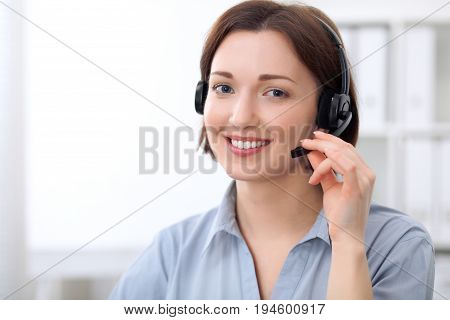 Young beautiful business woman in headset. Call center.