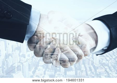 Close up of handshake with forex chart on bright city background. Finance and partnership concept. Double exposure