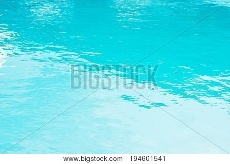 Blue ripped water in swimming pool, abstract background