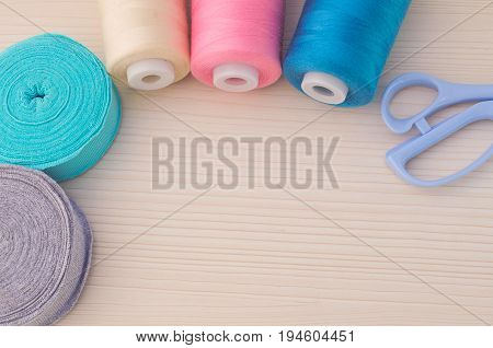 Sewing kit. Thread blue, pink, beige, scissors,rolls ribana grey and menthol