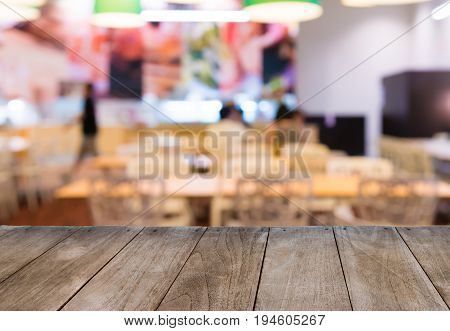 Empty Wooden Table In Front Of Blurred Background Of Restaurant Tables And Chairs