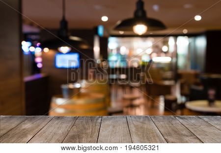 Empty Wooden Table In Front Of Blurred Background Of Tables And Bar Chairs