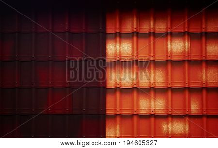 Tile. Tile roof, tiled roof. Abstract image tile. Red brown tile. Abstract background. Tan.