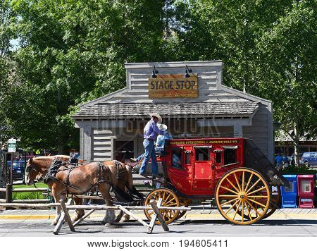 JACKSON HOLE, WYOMING - JUNE 27, 2017: Town Square Stagecoach Ride. Visitors can enjoy a leisurely Stagecoach Ride and tour of historic Jackson Hole.